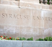 Wall with the words Syracuse University etched in it.